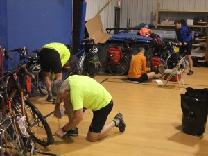 John, Jerry Jonathan and Paul prepare  their bikes at the Freda Harris Baptist Church for the next day of hill climbing